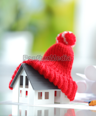 energy saving red knitted hat on
