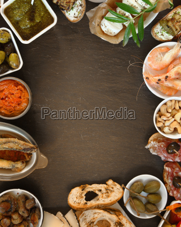 assorted tapas on table with copy