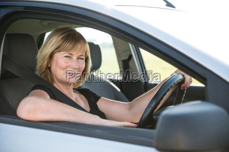 portrait of senior woman in car