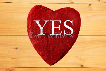red heart with yes lettering and