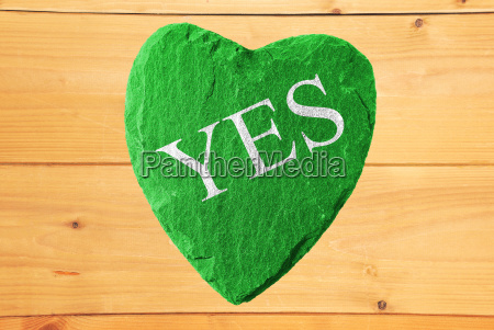 green heart with yes lettering and