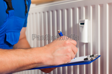 technician reads the heating