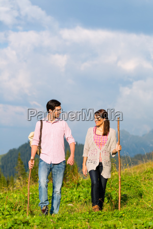 alps couple hiking in the