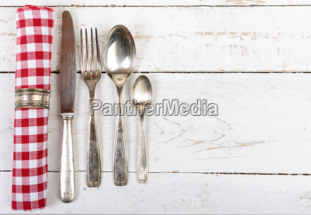 antique cutlery and towel on the