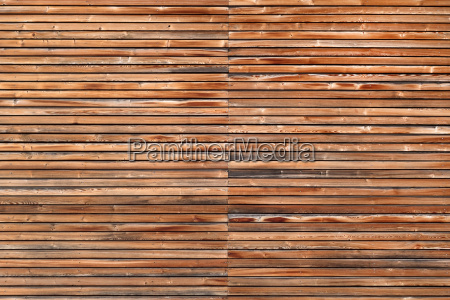 wooden facade with horizontal battens in
