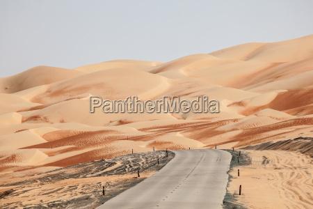 road through the desert in liwa