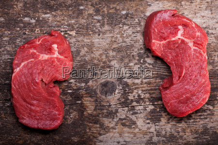 two, raw, steaks, on, a, wooden - 13643384