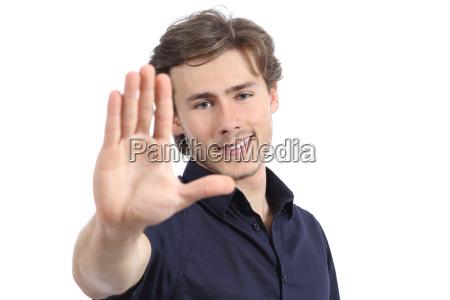 handsome man gesturing stop or framing