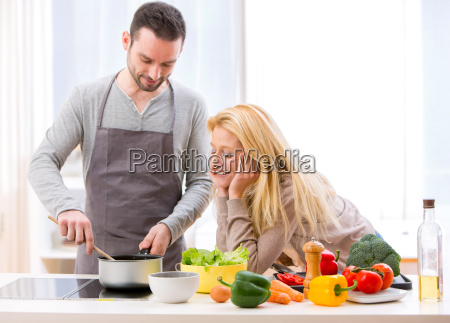young attractive woman give food to