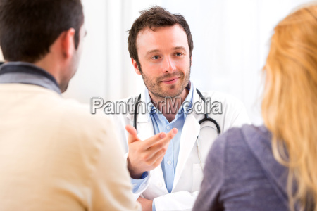 young attractive doctor advising a young