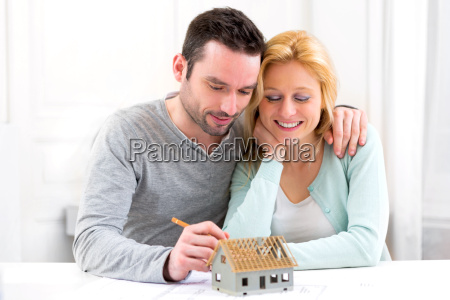 young attractive 30s couple making home