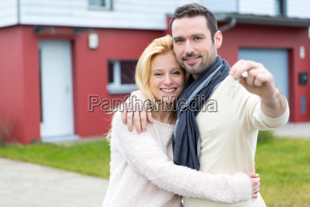 young happy couple in front of