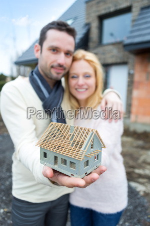 young happy couple handling a miniature