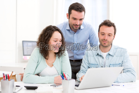 two interns working together assisted by