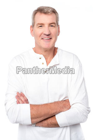 smiling man posing with folded arms
