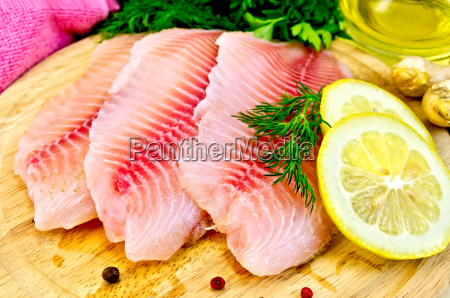 fillets, tilapia, with, oil, and, lemon - 13656788