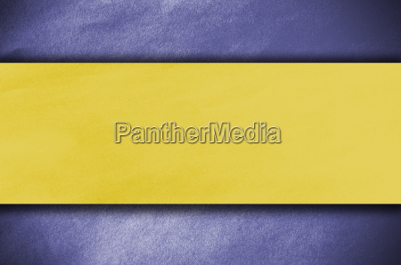 yellow papper on blue background