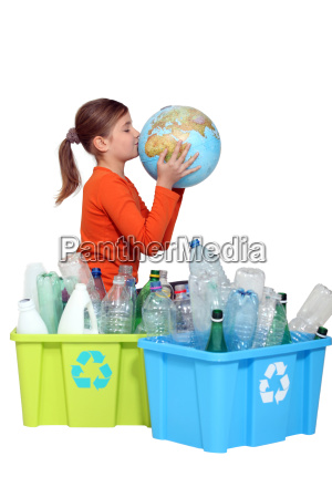 young girl kissing the planet next