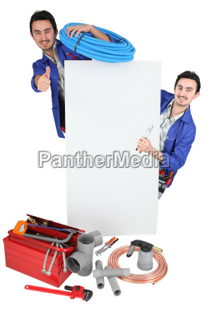 tradesman posing with his tools and