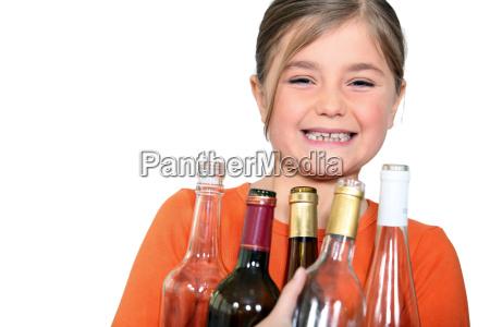little girl with empty bottles