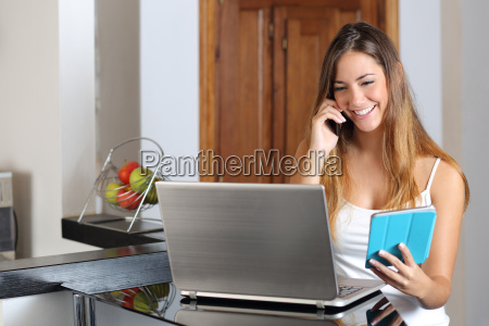 woman multi tasking working with a