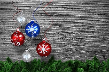 composite image of digital hanging christmas