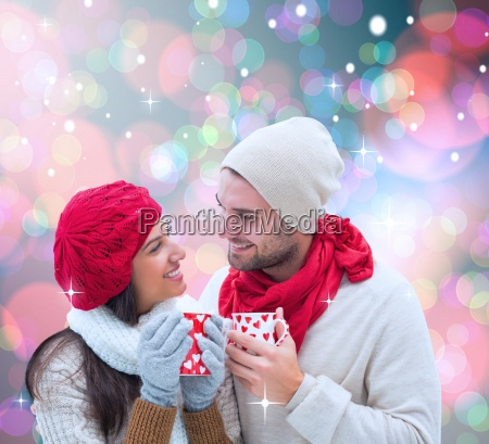 composite image of winter couple holding