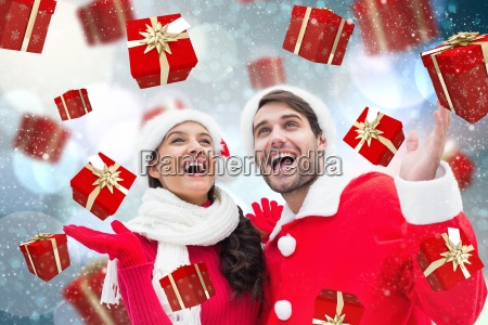 composite image of festive young couple