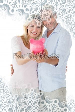 composite image of happy couple showing