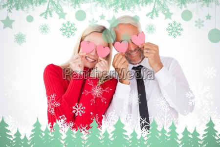 composite image of silly couple holding