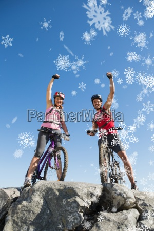 composite image of fit cyclist couple