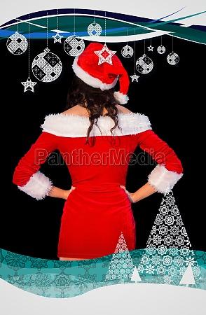 pretty brunette in santa outfit posing