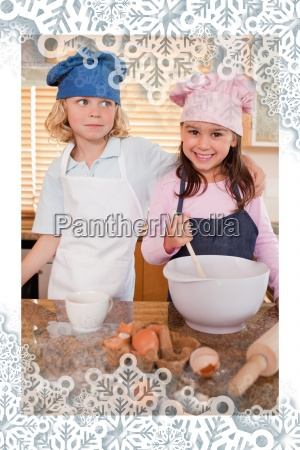 portrait of siblings baking together