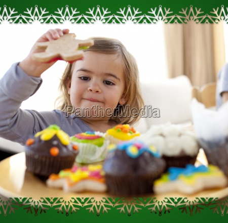 happy little girl eating confectionery at