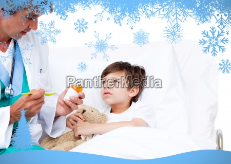 happy little boy taking cough medicine