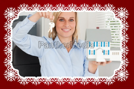 gorgeous businesswoman presenting model house and
