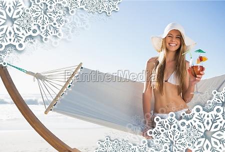 smiling blonde wearing sunhat sitting on