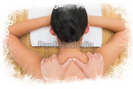 peaceful brunette enjoying a back massage