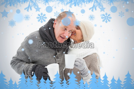 happy mature couple in winter clothes