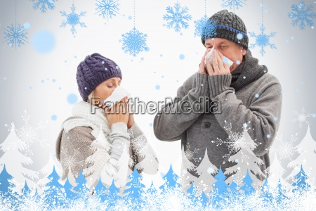 sick mature couple blowing their noses