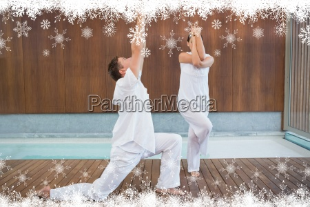 peaceful couple in white doing yoga