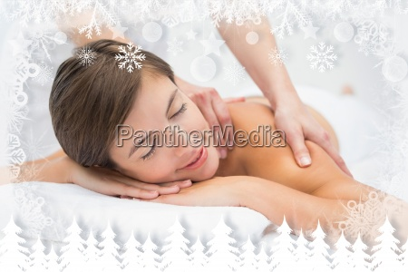 attractive young woman receiving shoulder massage