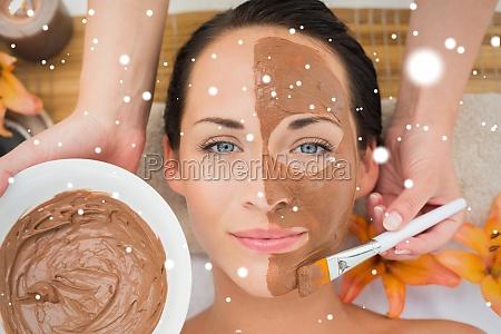 peaceful brunette getting a mud facial