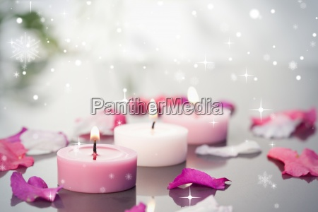 composite image of lighted candles and