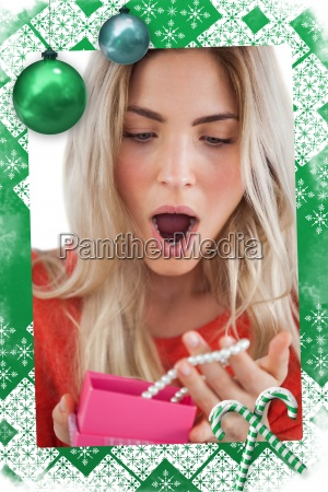 shocked woman discovering necklace in a
