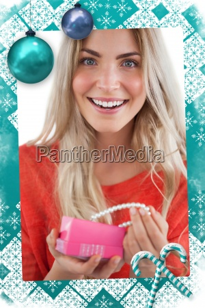 cheerful woman discovering necklace in a
