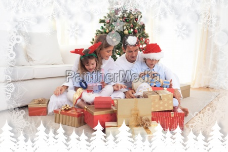 composite image of young family unpacking