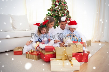 young family unpacking christmas presents