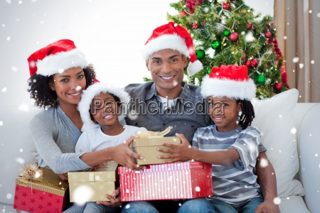 smiling family sharing christmas presents
