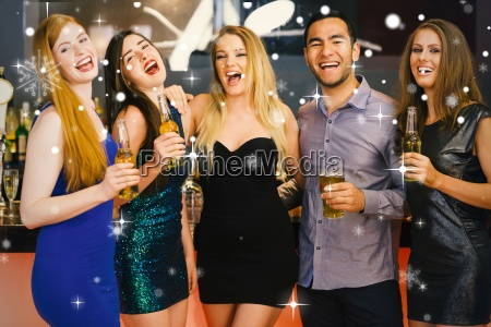 composite image of laughing friends holding